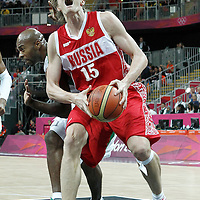 02 August 2012: Russia Andrei Kirilenko is fouled by Brazil Larry Taylor during 75-74 Team Russia victory over Team Brazil, during the men's basketball preliminary, at the Basketball Arena, in London, Great Britain.