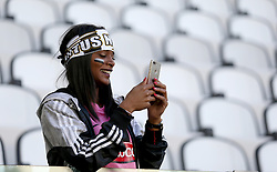 A Juventus fan in the stands before kick-off