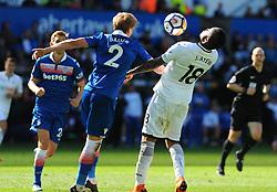 Jordan Ayew of Swansea City and Moritz Bauer of Stoke City comet for the highball  -Mandatory by-line: Nizaam Jones/JMP- 13/05/2018 - FOOTBALL - Liberty Stadium - Swansea, Wales - Swansea City v Stoke City - Premier League