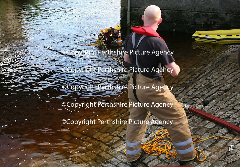 Tayside Fire & Rescue firefighters training with new river rescue equipment on the River Tay in Perth. 14.08.07<br /> A firefighter pulls his rescued colleague out of the river<br /> <br /> Picture by Graeme Hart.<br /> Copyright Perthshire Picture Agency<br /> Tel: 01738 623350  Mobile: 07990 594431
