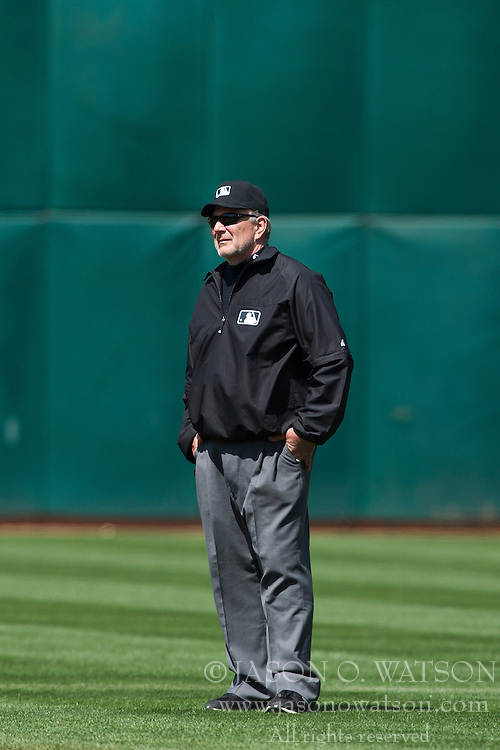 OAKLAND, CA - APRIL 27: MLB umpire Bob Davidson stands behind second base during the fifth inning between the Oakland Athletics and the Baltimore Orioles at O.co Coliseum on April 27, 2013 in Oakland, California. The Baltimore Orioles defeated the Oakland Athletics 7-3. (Photo by Jason O. Watson/Getty Images) *** Local Caption *** Bob Davidson