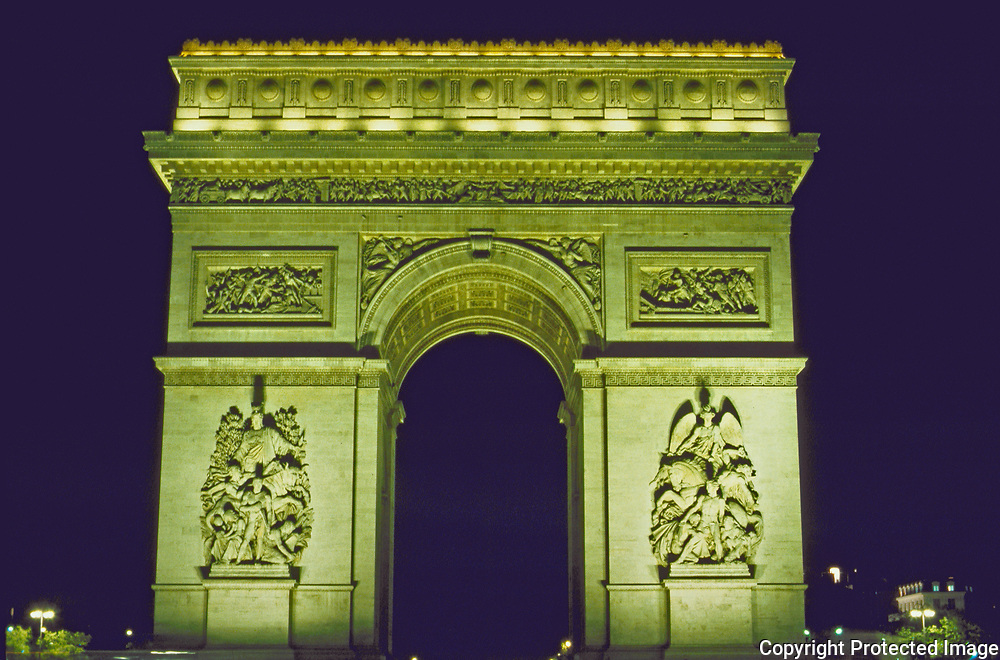 Night views of Paris the majestic Arc de Triomphe one of the most famous sites of Paris on the Rive Doit lit by floodlights and seen from miles away and sits at the end of the world famous elegant street the Champs Elysees.