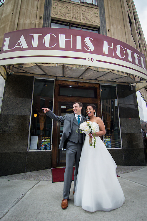 A bride and groom outside the Latchis Hotel in Brattleboro, VT.