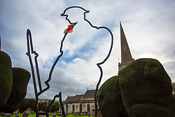 © Licensed to London News Pictures 08/11/2018, Painswick, UK. The metal outline of a soldier stands in the garveyard of St Mary's church Painswick with a single red poopy attached to the breast ahead of the 100th year anniversary fo the First World War this coming Sunday, November 11th, 2018. Photo Credit : Stephen Shepherd/LNP