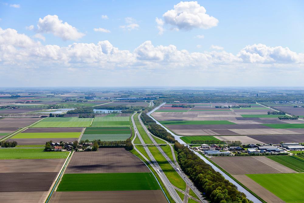 Nederland, Flevoland, Gemeente Noordoostpolder, 07-05-2015; Rijksweg A6 ter hoogte van Bant, Emmeloord aan de horizon.<br /> Motorway through the new polder Noordoostpolder.<br /> luchtfoto (toeslag op standard tarieven);<br /> aerial photo (additional fee required);<br /> copyright foto/photo Siebe Swart