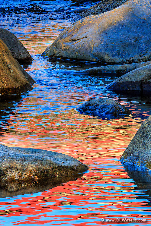 Reflection of fall leaves in the Swift River along the Kancamangus Highway in the White Mountains of New Hampshire.