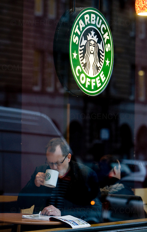 On Shift for Herald..A coffee drinkers sits at a Starbucks shop in Edinburghs George Street as the company announce 7,000 redundancies...29/1/2009.Picture Michael Hughes/Maverick