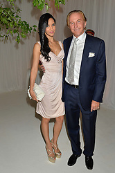 GEOFFREY KENT and his wife OTAVIA JARDIM at a dinner hosted by Cartier in celebration of The Chelsea Flower Show held at The Hurlingham Club, London on 19th May 2014.
