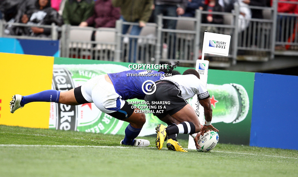 AUCKLAND, NEW ZEALAND - SEPTEMBER 25,  Nemia Kenatale gets to the ball 1st to stop Alesana Tuilagi from getting a touch down for a try during the 2011 Rugby World Cup match between Fiji and Samoa at Eden Park on September 25, 2011 in Auckland, New Zealand<br /> Photo by Steve Haag / Gallo Images