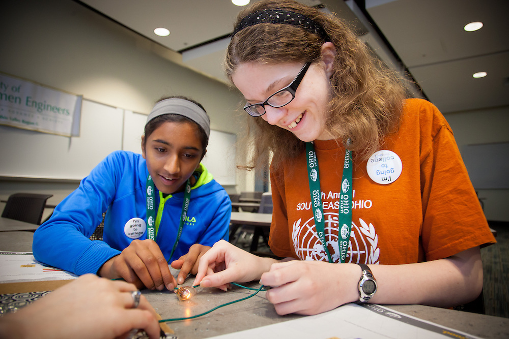 Shifra Narasimhan, left and Abigail Tadlock learn to build a simple circuit during the Tech Savvy workshop at Ohio University May 17, 2014.  The event exposes girls from sixth through ninth grade to thee field of science, technology, engineering and math.   Photo by Ohio University / Jonathan Adams