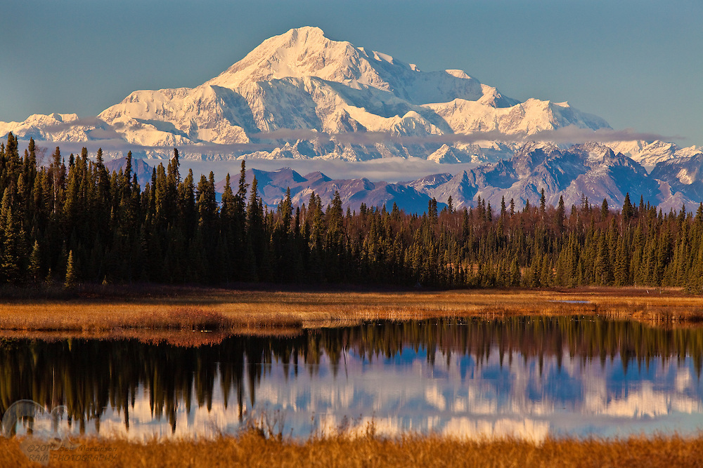 The southern slopes of Denali (the great one in native Athabaskan language) or formerly called Mount Mckinley reflects into a pond in  late afternoon sunshine in the fall of 2009. Denali is the gem of the Alaska Range and is the highest peak in North America.