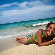A Cuban woman lies on the beach at Maguana beach, near Baracoa, Cuba on Sunday July 13, 2008.