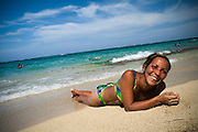A Cuban woman lies on the beach at Maguana beach, near Baracoa, Cuba on Sunday July 13, 2008.