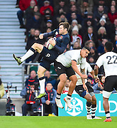 England's George Ford beats Fijian Josh Matavasi to a high ball during the Autumn International Series match between England and Fiji at Twickenham, Richmond, United Kingdom on 19 November 2016. Photo by Ian  Muir.