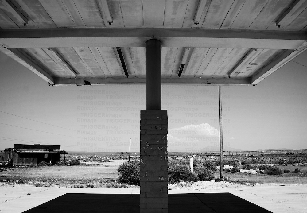 arizona deserted building gas station landscape architecture awning in black and white at two guns ghost town along route 66 just east of flagstaff.  two guns was a popular tourist destination before the creation of interstate 40 bypassed the town.