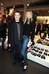 JADE PARFITT and TOBY BURGESS at a preview of the H&M Comme des Garcons collection held at H&M Regent Stret, London on 12th November 2008.
