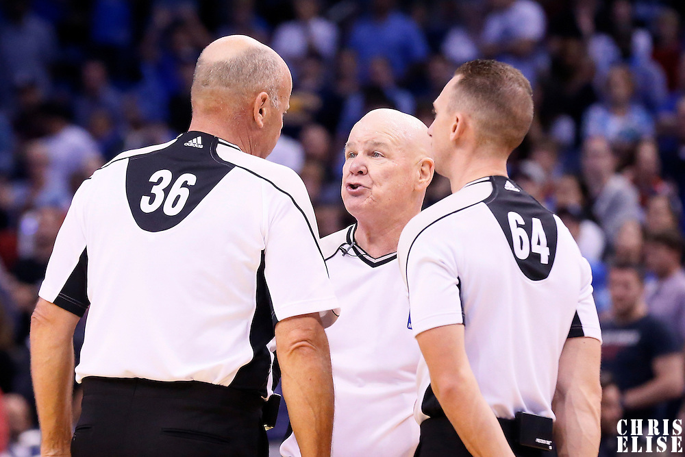 30 October 2015: referee Joe Crawford (17) talks to referee David Jones (36) and referee Justin Van Duyne (64) during the Oklahoma City Thunder 139-136 double overtime victory over the Orlando Magic, at the Amway Center, in Orlando, Florida, USA.