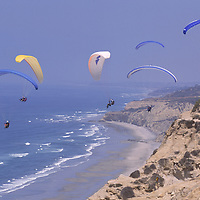 Hangliders and paragliders take flight from the Torrey Pines Gliderport in San Diego and fly over the Pacific Ocean, pristine beaches and rocky bluffs.