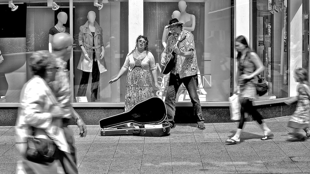 """Busking musicians sing and dance during the We Are Bedford organised event """"The Bedford Buskfest 2011"""" held in Bedford town centre over the weekend of 23rd and 24th July 2011"""