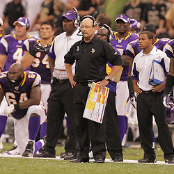 2008 October, 06: Minnesota Vikings Head Coach Brad Childress (center) calls in a play from the sideline during a week five regular season game between the Minnesota Vikings and the New Orleans Saints for Monday Night Football at the Louisiana Superdome in New Orleans, LA.