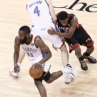 14 June 2012: Oklahoma City Thunder guard James Harden (13) drives past Miami Heat point guard Norris Cole (30) on a screen set by Oklahoma City Thunder power forward Nick Collison (4) during the Miami Heat 100-96 victory over the Oklahoma City Thunder, in Game 2 of the 2012 NBA Finals, at the Chesapeake Energy Arena, Oklahoma City, Oklahoma, USA.