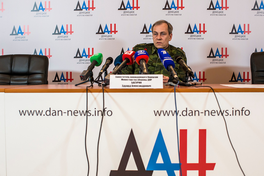 DONETSK, UKRAINE - FEBRUARY 3, 2015: Eduard Basurin, deputy commander of the Donetsk People's Republic, speaks at a news conference in Donetsk, Ukraine. As fighting between Ukrainian and rebel forces remains fierce, rebels today claimed that they downed both a helicopter and an airplane belonging to Ukrainian forces over the past 24 hours. CREDIT: Brendan Hoffman for The New York Times
