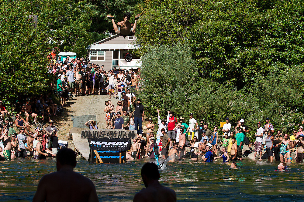 A finalist in the Ron's House of Big Air competition prepares to swan dive high above the river as his bike hits the water at The Downieville Classic, July 10, 2010.