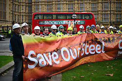 © Licensed to London News Pictures. 28/10/2015. London, UK. Steel workers erect a banner infront of The Houses of Parliamnet in London to demonstrate against the decline in the british steel industry and recent closures of steel plants in the UK Photo credit: Ben Cawthra/LNP