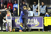 AFC Wimbledon striker Lyle Taylor (33) hugging AFC Wimbledon manager Neal Ardley during the EFL Sky Bet League 1 match between AFC Wimbledon and Southend United at the Cherry Red Records Stadium, Kingston, England on 1 January 2018. Photo by Matthew Redman.