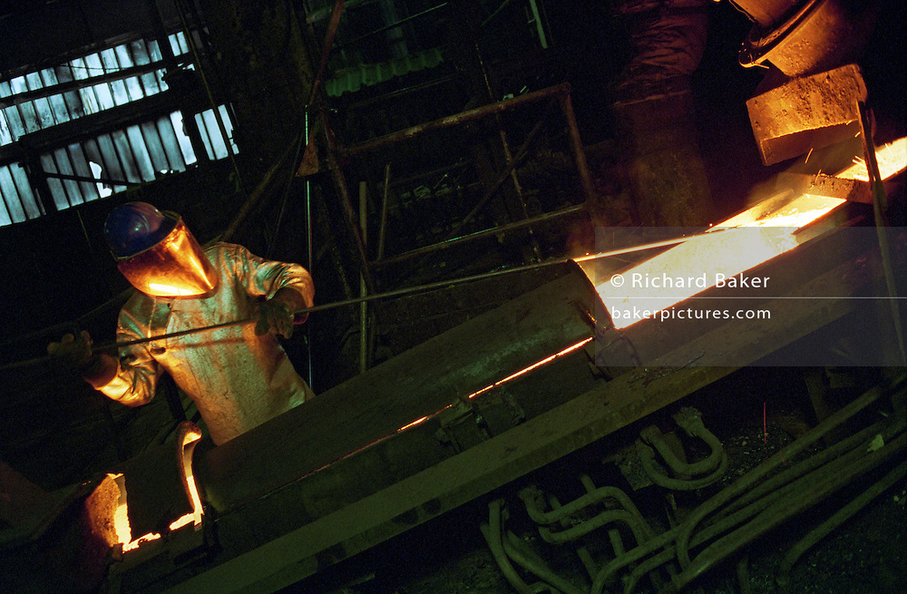 A Bulgarian copper manufacturing worker tends to molten metals in the Pirdop refinery.The Pirdop copper smelter and refinery is the biggest in the Balkans and whole of South-Eastern Europe. It was privatized in 1997 for $80,000,000 and is now owned by the German  Aurubis. It has a capacity of 160,000 tons and additional capacity of 180,000 tons worth EUR82,000,000 is being built. The factory also produces 830,000 tons of sulphuric acid and employs 1,420 workers. Pirdop is a town located in South-West Bulgaria of Sofia Province in the southeastern part of the Zlatitsa.