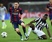 Paul Pogba (R), Lionel Messi <br /> Berlino 06-06-2015 OlympiaStadion  <br /> Juventus Barcelona - Juventus Barcellona <br /> Finale Final Champions League 2014/2015 <br /> Foto Matteo Gribaudi/Image Sport/Insidefoto