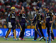 Piyush Chawla of the Kolkata Knight Riders celebrates the wicket of Virender Sehwag of the Kings X1 Punjab during match 15 of the Pepsi Indian Premier League 2014 Season between The Kings XI Punjab and the Kolkata Knight Riders held at the Sheikh Zayed Stadium, Abu Dhabi, United Arab Emirates on the 26th April 2014<br /> <br /> Photo by Pal Pillai / IPL / SPORTZPICS