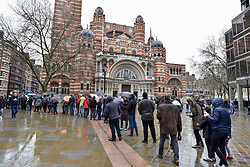 © Licensed to London News Pictures. 08/04/2018. LONDON, UK.  Hungarian expats queue in the rain to visit the polling station near Westminster Cathedral to vote in the Hungarian general election, with queues extending around the block.  Opinion polls indicate that Prime Minister Viktor Orban and his Fidesz party will secure a third straight term..  Photo credit: Stephen Chung/LNP