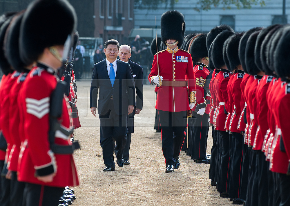 © London News Pictures 20/10/2015. Major Benjamin Jesty was joined by president Xi and the Duke of Edinburgh inspecting troops from 1st battalion Grenadier Guards on Horse Guards Parade during the ceremony<br /> <br /> More than 1,100 soldiers and 230 horses joined HM The Queen, HRH The Duke of Edinburgh, The Duke and Duchess of Cornwall, the Prime Minister, Senior members of the Cabinet, the Lord Mayor of London, the Mayor of London, and the Defence Chiefs of Staff for the ceremonial welcome to Britain of The President of The People's Republic of China and Madame Peng Liyuan . Photo credit: Rupert Frere/LNP