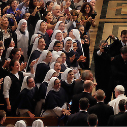Religious, seminarians and faithful cheered Pope Francis as he entered the Basilica of the National Shrine of the Immaculate Conception in Washington, D.C Wednesday, Sept. 23, 2015. Prior to celebrating a Mass of Canonization for Junipero Serra at the basilica, he offered those inside the basilica a blessing,  Photo by Teak Phillips / St. Louis Review