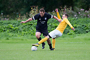 Cannon Fodder (black) v Park Tool (yellow) in the Dundee Saturday Morning Football League at Drumgeith