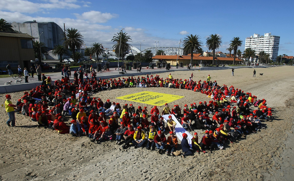 Amnesty International, Get Up!, the Refugee Council of Australia and hundreds of Melbourne residents form a giant red and white human life ring on St Kilda Beach. They aim to show politicians that Australians believe in saving lives by helping refugees fleeing war and persecution.    08/05/2010 Pic By Craig Sillitoe melbourne photographers, commercial photographers, industrial photographers, corporate photographer, architectural photographers, This photograph can be used for non commercial uses with attribution. Credit: Craig Sillitoe Photography / http://www.csillitoe.com<br />