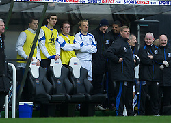 NEWCASTLE, ENGLAND - Saturday, March 5, 2011: Everton's captain Phil Neville watches from the bench with substitutes Diniyar Bilyaletdinov, Shane Duffy and Jose Baxter during the Premiership match against Newcastle United at St. James' Park. (Photo by David Rawcliffe/Propaganda)
