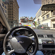 Driving my old Ford Focus in downtown Kansas City traffic along Grand Avenue.