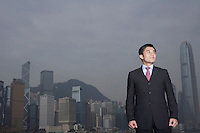 Portrait of young business man office building in background