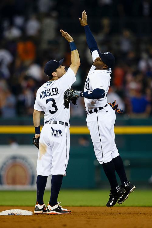 Jun 9, 2015; Detroit, MI, USA; Detroit Tigers second baseman Ian Kinsler (3) and Detroit Tigers center fielder Rajai Davis (20) celebrate after the game at Comerica Park. Mandatory Credit: Rick Osentoski-USA TODAY Sports