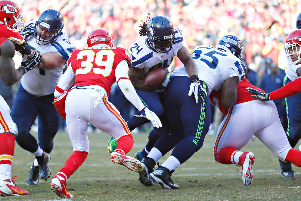 KANSAS CITY, MO - NOVEMBER 16:  Marshawn Lynch #24 of the Seattle Seahawks runs the ball in the third quarter of a game against the Kansas City Chiefs at Arrowhead Stadium on November 16, 2014 in Kansas City, Missouri.  The Chiefs defeated the Seahawks 24-20.  (Photo by Wesley Hitt/Getty Images) *** Local Caption *** Marshawn Lynch