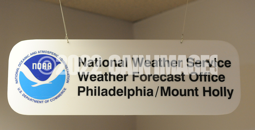 a sign hangs in the office office of the National Weather Service Mount Holly Station Tuesday August 23, 2016 in Mt. Holly, New Jersey. (Photo by William Thomas Cain)