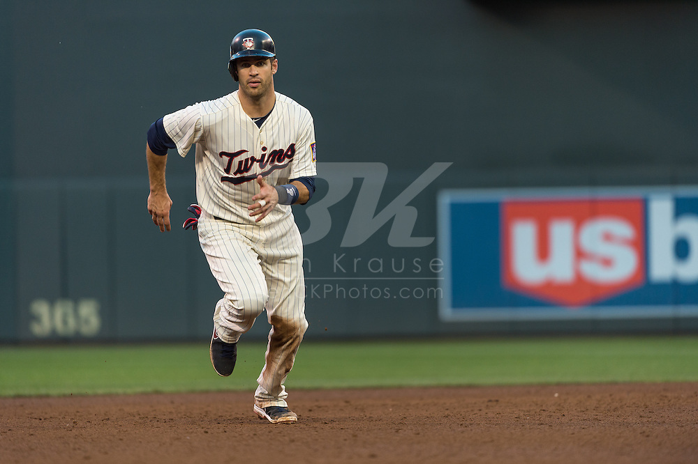 Joe Mauer #7 of the Minnesota Twins runs for 3rd base during a game against the Detroit Tigers on June 15, 2013 at Target Field in Minneapolis, Minnesota.  The Twins defeated the Tigers 6 to 3.  Photo: Ben Krause