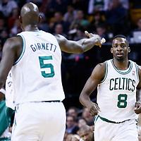 14 January 2013: Boston Celtics power forward Jeff Green (8) is congratulated by Boston Celtics power forward Kevin Garnett (5) during the Boston Celtics 100-89 victory over the Charlotte Bobcats at the TD Garden, Boston, Massachusetts, USA.