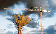 Construction site crane with storm clouds