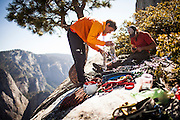 Climbers Alex Honnold and Dave Allfrey pack up after a speed record on Tangerine Trip on El Capitan in Yosemite National Park.