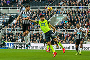 Fabian Schar (#5) of Newcastle United leaps to direct a header towards goal during the Premier League match between Newcastle United and Huddersfield Town at St. James's Park, Newcastle, England on 23 February 2019.