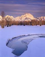Winter sunrise over the Teton Range from Spread Creek, Grand Teton National park Wyoming USA