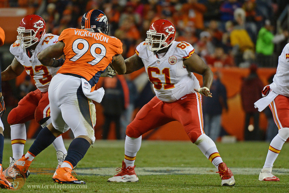 November 17, 2013; Denver, CO, USA; Kansas City Chiefs center Rodney Hudson (61) blocks Denver Broncos defensive tackle Kevin Vickerson (99) during the second quarter at Sports Authority Field at Mile High. The Broncos defeated the Chiefs 27-17.